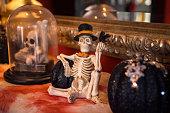 Halloween skeleton figurine decor on mantlepiece