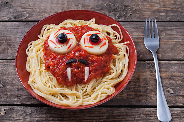 Halloween spaghetti face with big eyeballs fangs and moustaches in stock photo