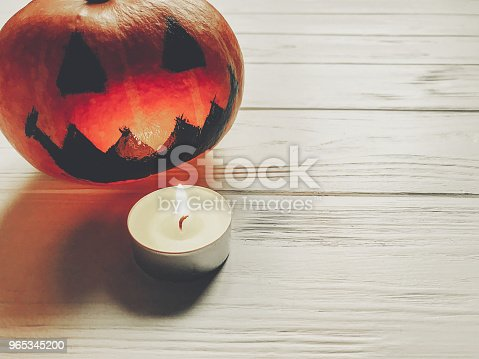 Halloween Spooky Jack Lantern Pumpkin With With Candle Light On Wooden Background Holiday Celebration Seasonal Greetings Happy Halloween Concept Space For Text Stock Photo & More Pictures of Autumn
