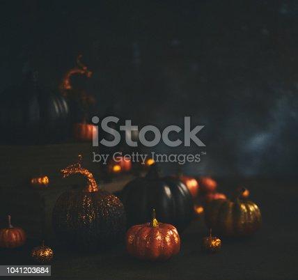 Halloween still life background with orange and black glittery pumpkins