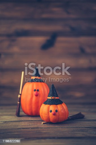 istock Halloween still life background with witch couple made from pumpkins 1166322260