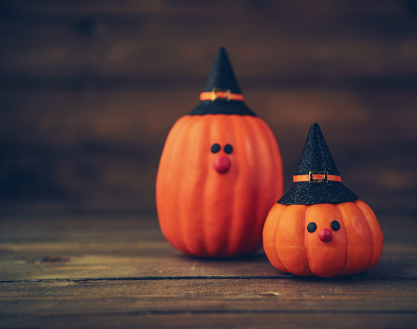 Halloween still life background with witch couple made from pumpkins