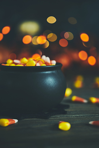 Halloween still life with cauldron and candy corn
