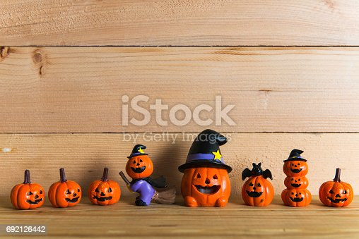 483328044 istock photo Halloween still life with pumpkins and Halloween holiday text 692126442