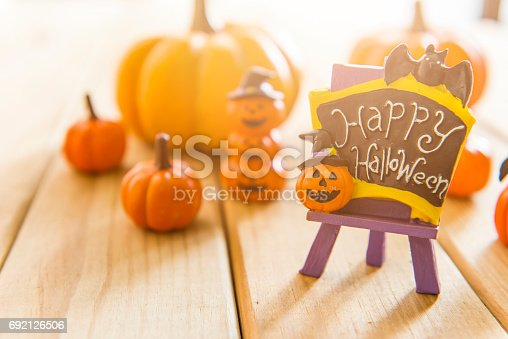483328044 istock photo Halloween still life with pumpkins and Halloween holiday text 692126506