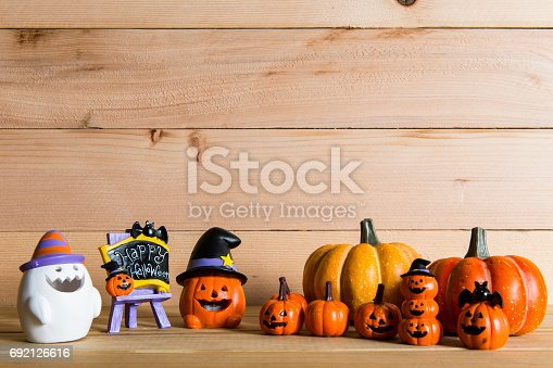 483328044 istock photo Halloween still life with pumpkins and Halloween holiday text 692126616