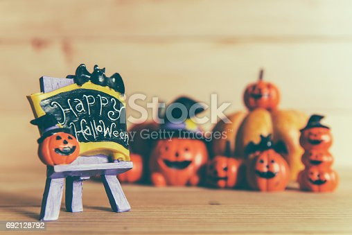 483328044 istock photo Halloween still life with pumpkins and Halloween holiday text 692128792