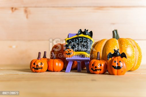 483328044 istock photo Halloween still life with pumpkins and Halloween holiday text 692128872