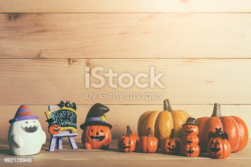 483328044 istock photo Halloween still life with pumpkins and Halloween holiday text 692128946