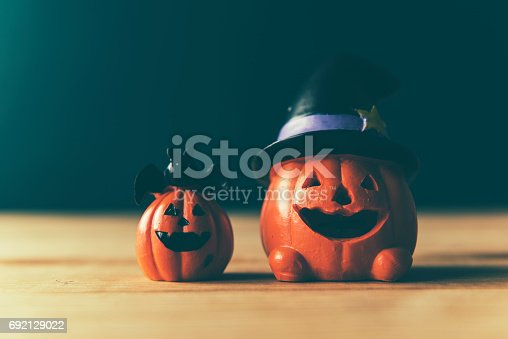 483328044 istock photo Halloween still life with pumpkins and Halloween holiday text 692129022