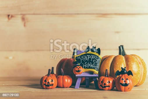 483328044 istock photo Halloween still life with pumpkins and Halloween holiday text 692129100