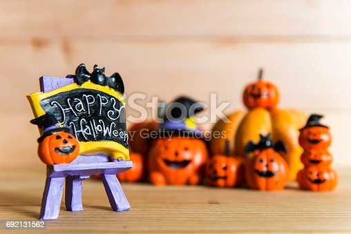 483328044 istock photo Halloween still life with pumpkins and Halloween holiday text 692131562