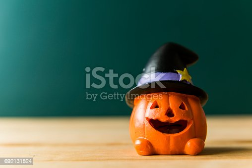 483328044 istock photo Halloween still life with pumpkins and Halloween holiday text 692131824