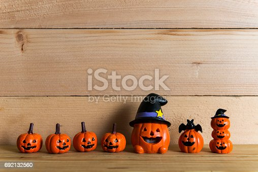 483328044 istock photo Halloween still life with pumpkins and Halloween holiday text 692132560