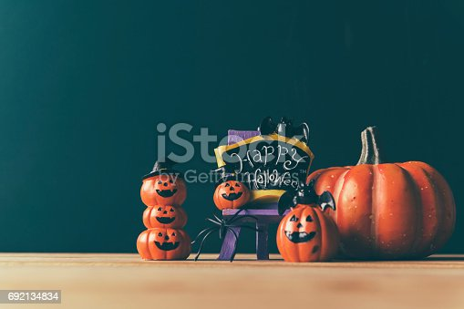483328044 istock photo Halloween still life with pumpkins and Halloween holiday text 692134834