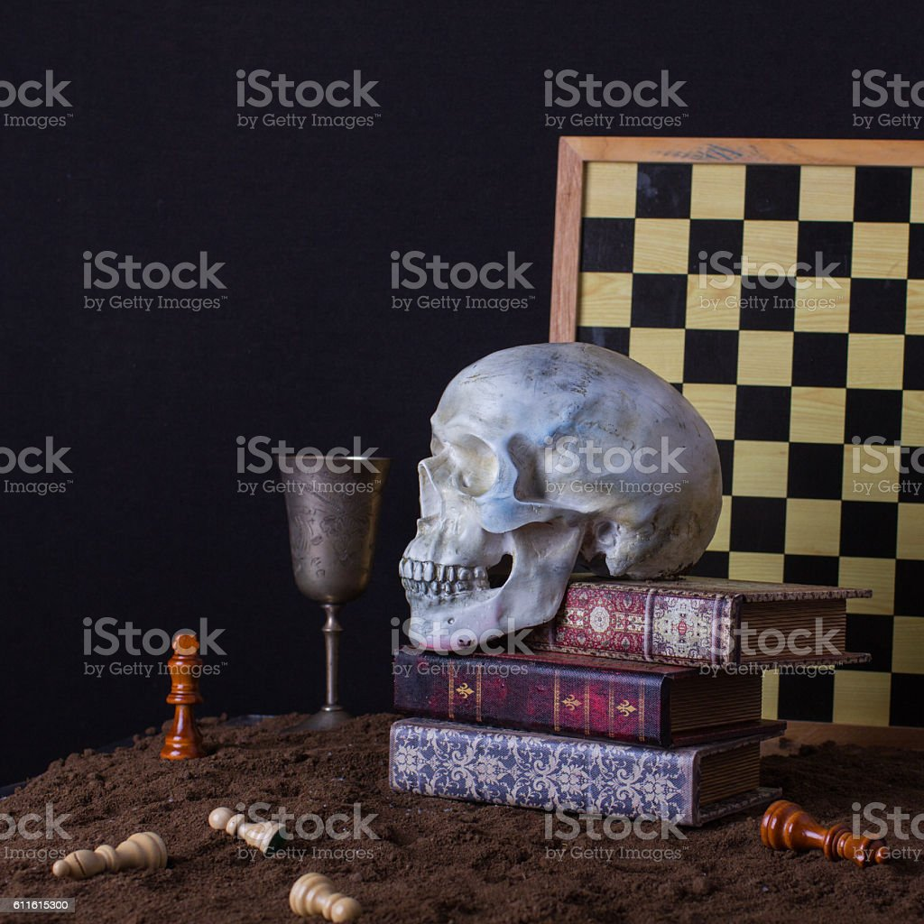 Halloween still life with skull, books and goblet of wine stock photo