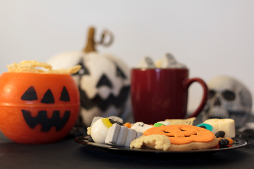 Halloween table with assorted fun and spooky treats