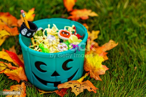 istock Halloween teal basket full of non-food treats 1035356776