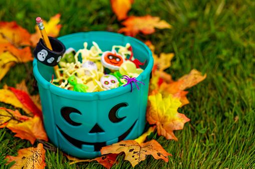 istock Halloween teal basket full of non-food treats 1035356776
