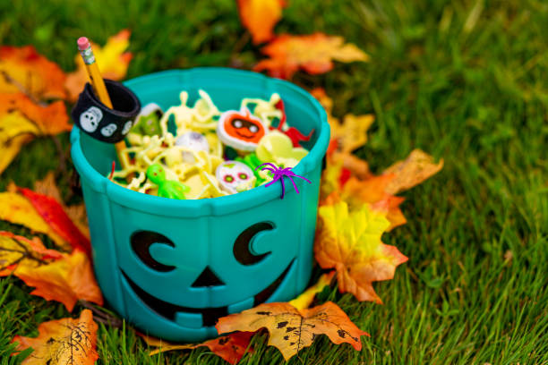 Halloween teal basket full of non-food treats stock photo