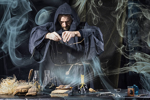 Halloween. The medieval alchemist holds magic ritual smoke stock photo