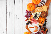 istock Halloween theme charcuterie side border against a white wood background 1272871536