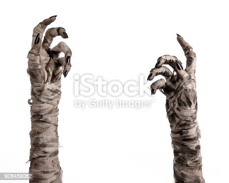 istock Halloween theme: terrible old mummy hands on a white background 928459082