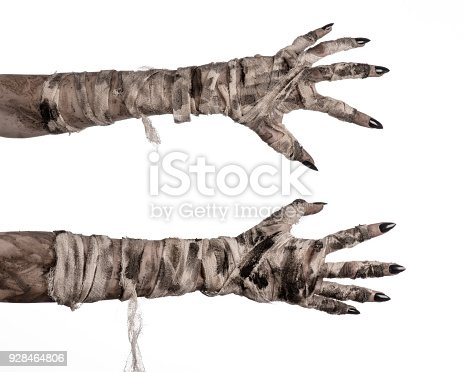 istock Halloween theme: terrible old mummy hands on a white background 928464806