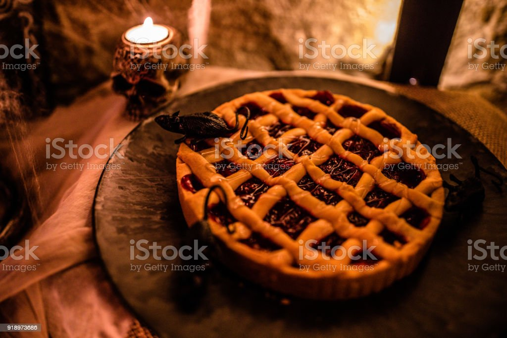 halloween themed pumpkin pie on halloween party food table royalty free stock photo