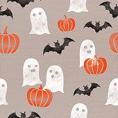 istock Halloween themed (pumpkins, ghosts, bats) seamless pattern, cardboard paper background 486542528