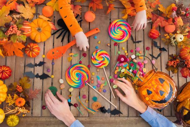 halloween trick or treat candy and pumpkin. - halloween candy стоковые фото и изображения
