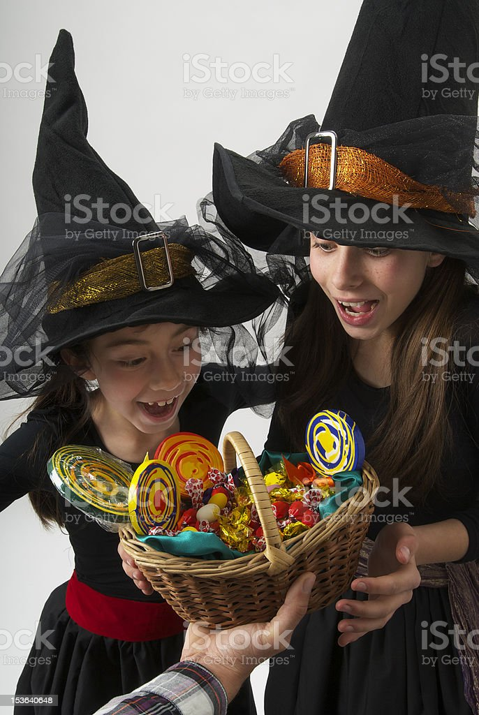 halloween, two girls disguised as witches royalty-free stock photo