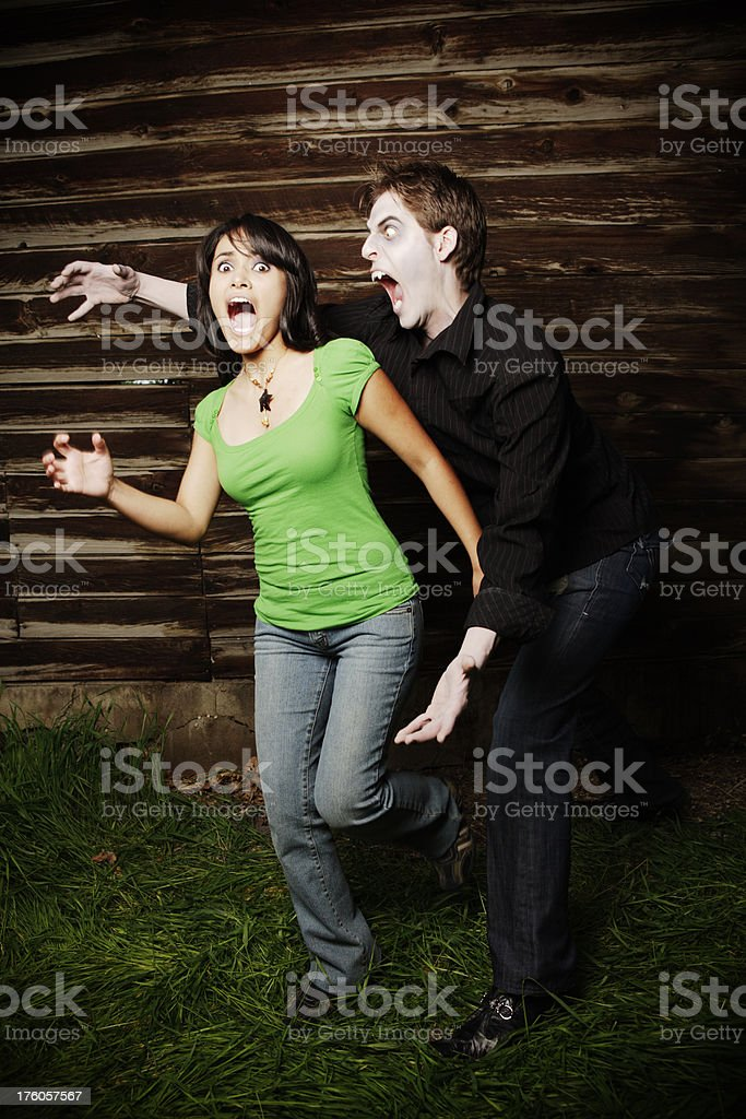 Halloween: vampire about to catch his female victim royalty-free stock photo