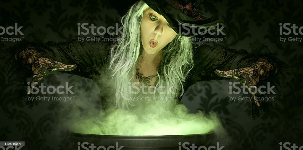 Halloween Witch Conjuring A Spell stock photo