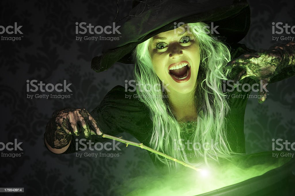 Halloween Witch Conjuring A Spell royalty-free stock photo