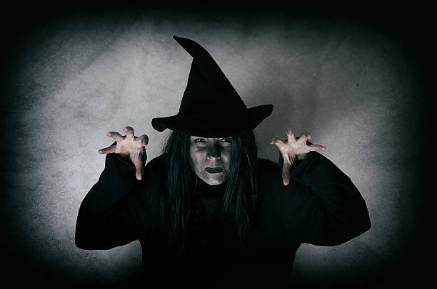 Halloween witch Halloween witch. Low key. Computer added dirt, scratches, grain and vignette. shock tactics stock pictures, royalty-free photos & images