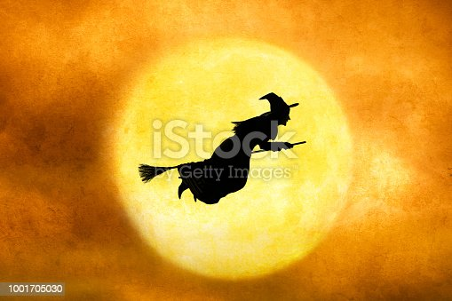 istock Halloween Witch Silhouetted Against Full Moon 1001705030