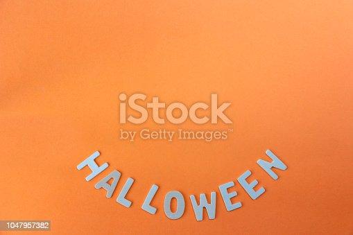 1057069236 istock photo Halloween word on orange background 1047957382