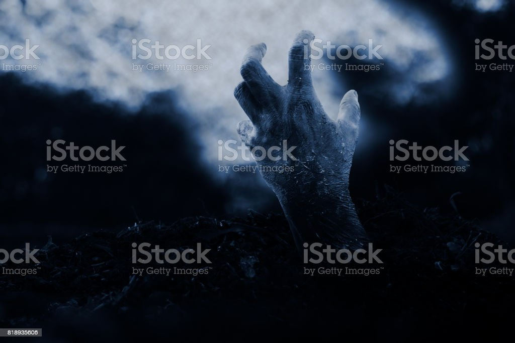 Halloween  zombie hand on dramatic dark cloud background. stock photo