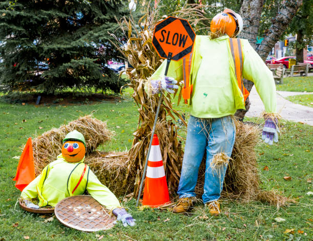 Halloween--Pumpkin Head Street Workers With SLOW Sign stock photo