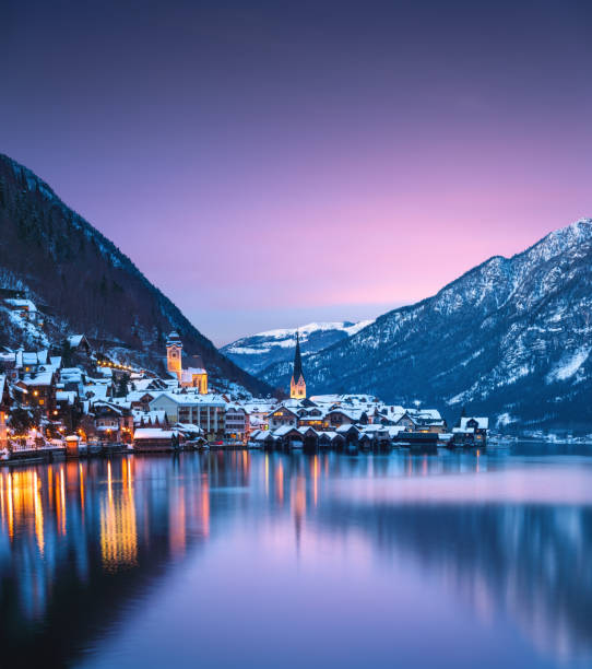 Hallstatt At Sunset Colorful winter evening in idyllic Austrian village Hallstatt. village stock pictures, royalty-free photos & images