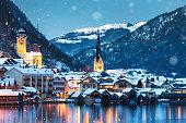 Tranquil snowy winter evening in idyllic Austrian village Hallstatt.