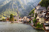 Hallstatt is a village in Upper Austria. Currently, a little over 900 people live there. It is in the Salzkammergut, a mountain regionin Austria. It lies on a lake.