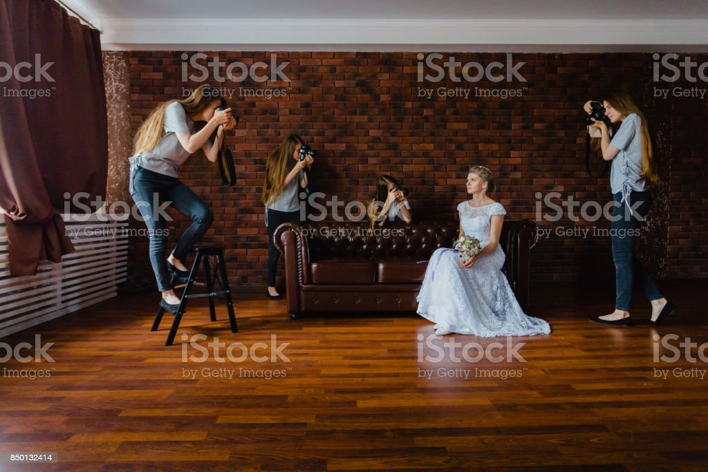 Hallucination of a bride with four photographers stock photo
