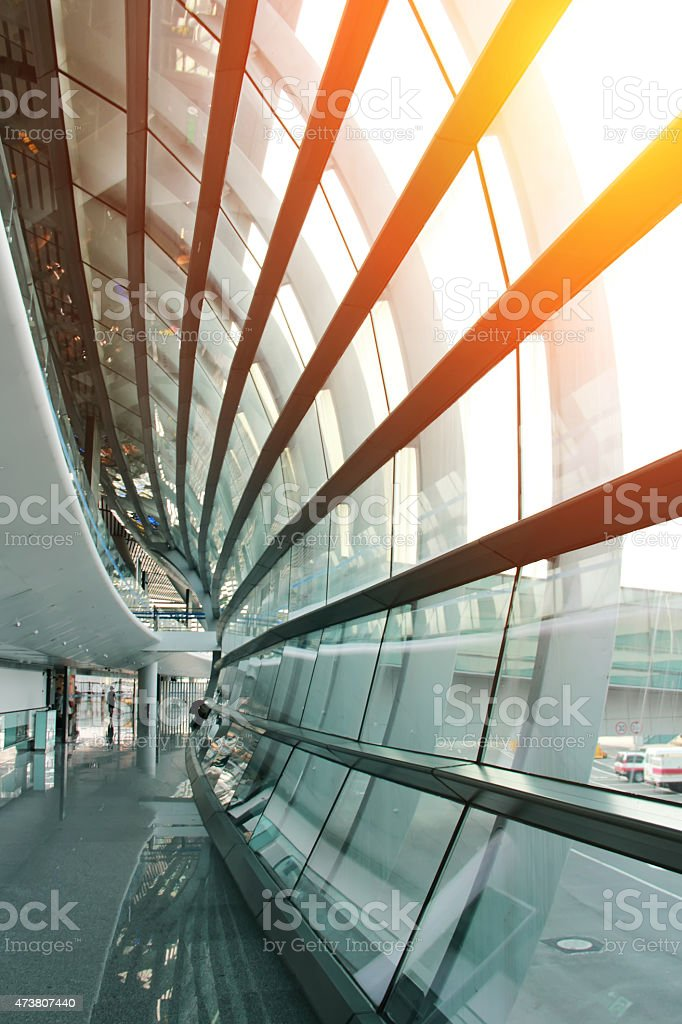 Hallway in a modern building with curving glass wall stock photo