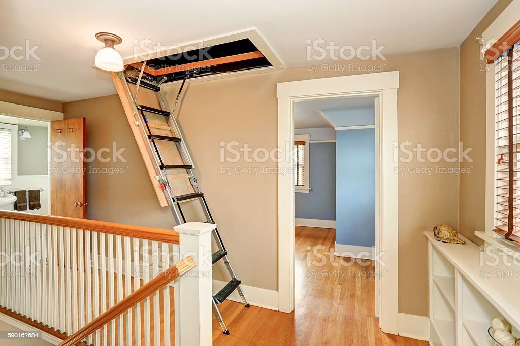 Hallway interior with folding attic ladder stock photo