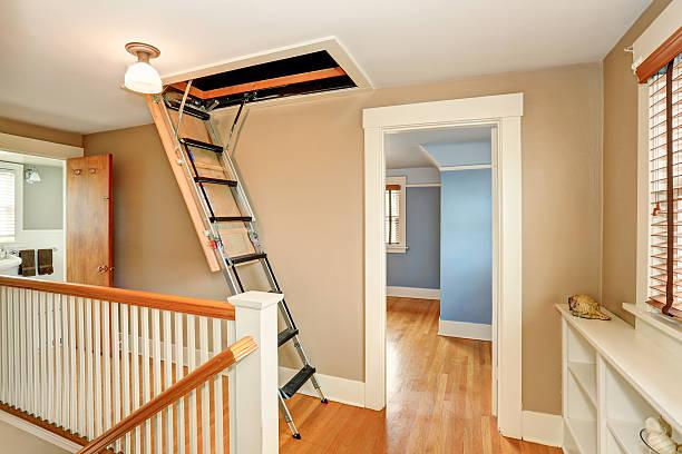 hallway interior with folding attic ladder - dachformen stock-fotos und bilder