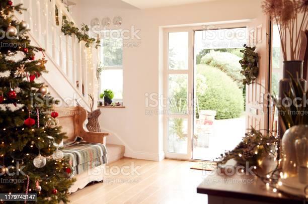 Hallway of home decorated for christmas viewed towards open front picture id1179743147?b=1&k=6&m=1179743147&s=612x612&h=li2bbvbv6z7hgtygtt kvrutgxbbarjvdpbkqqnkpkw=