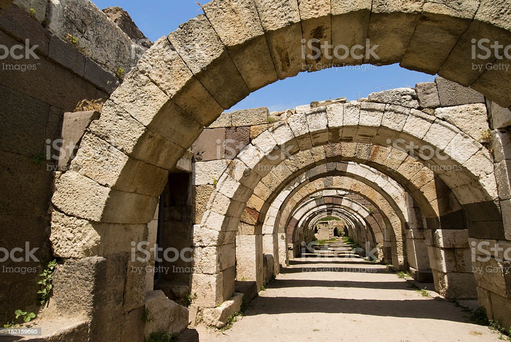Hallway of stone archways at the ruins of Agora stock photo