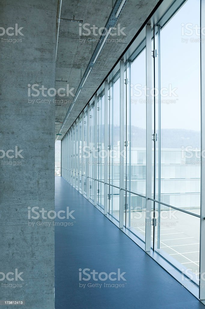 Hallway surrounded by windows in an office building royalty-free stock photo